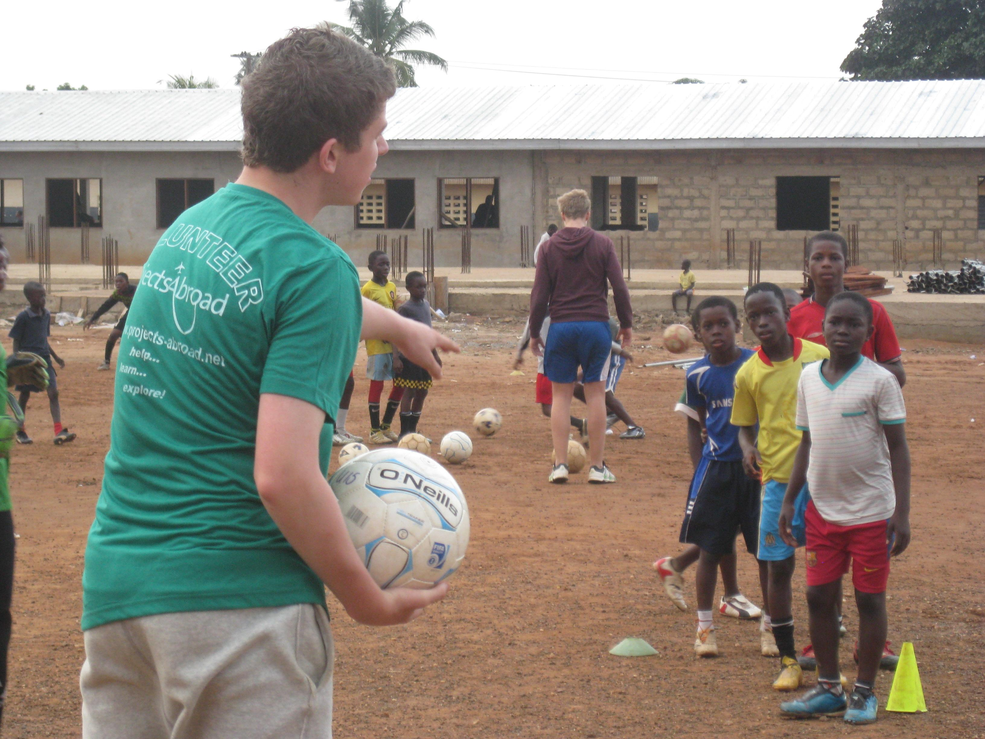 A football team practises drills during Projects Abroad's volunteer football coaching project in Ghana